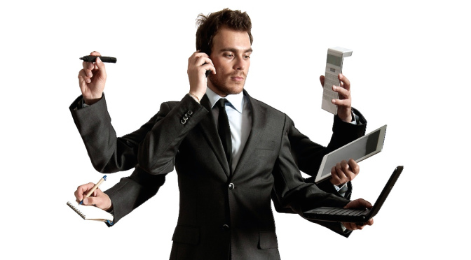 Businessman multitasking Photo